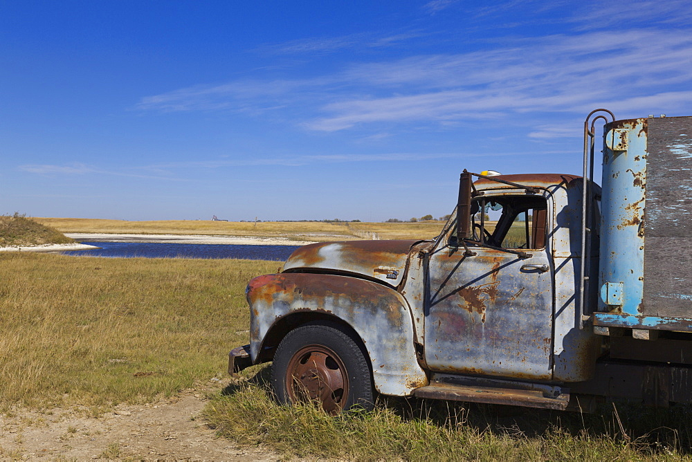 View of old truck on landscape at Highway 20, Saskatchewan, Canada
