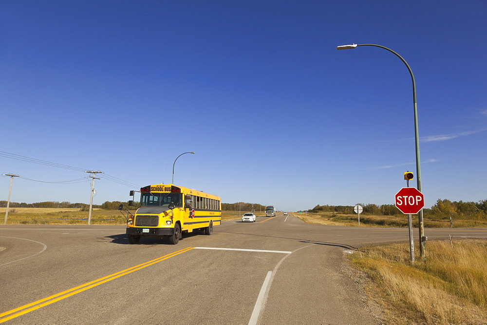 School bus crossing Highway 15 and 35, Saskatchewan, Canada