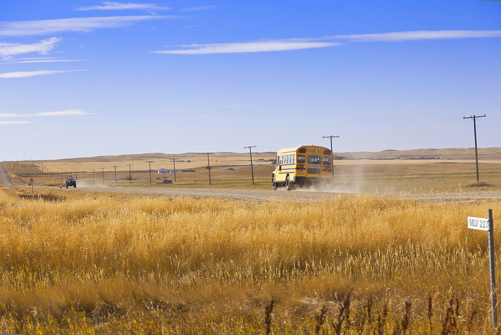 View of school bus on highway 4 North, Saskatchewan, Canada