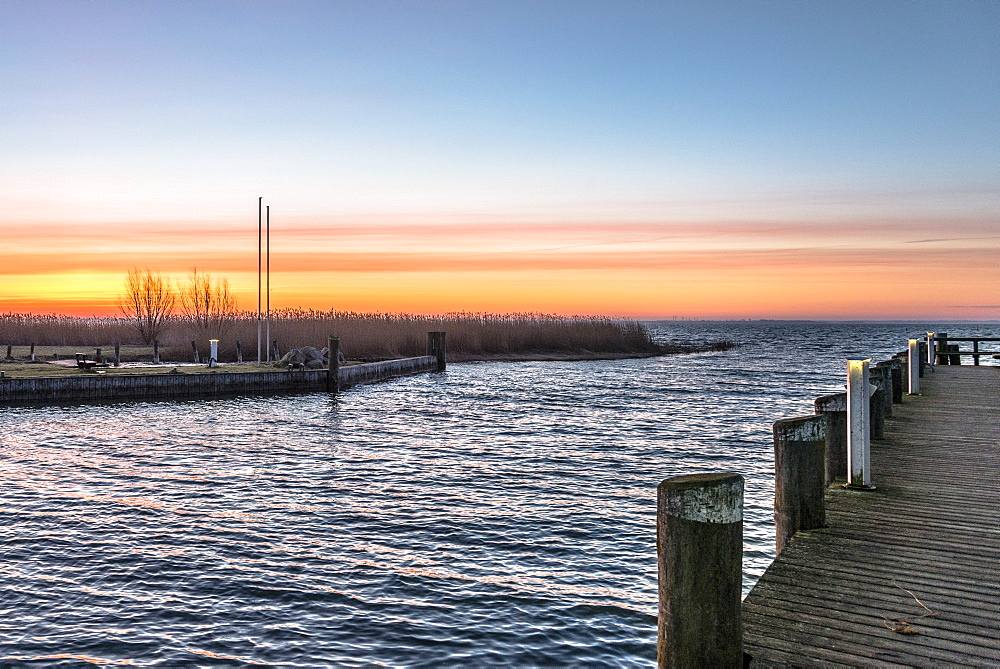 Sunset over the harbour in Ahrenshoop on the Baltic Sea