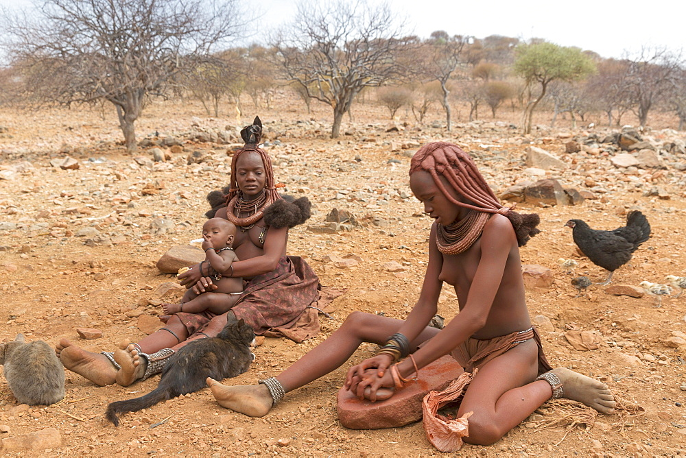 A mother and her children in a Himba village, indigenous tribe, Kunene, Namibia