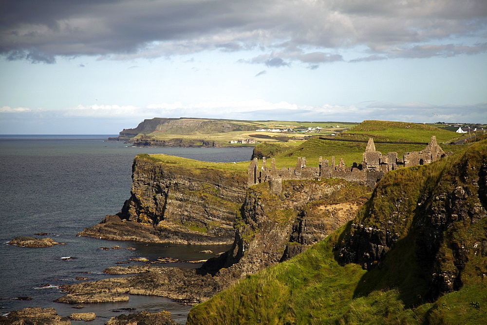 View of Dunluce Castle on cliffs and Atlantic Ocean in Ireland, UK