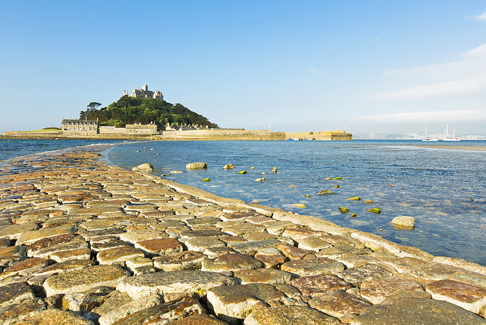 A cobbled path leading to St. Michaels Mount, a tidal island with a chapel in Cornwall (England)
