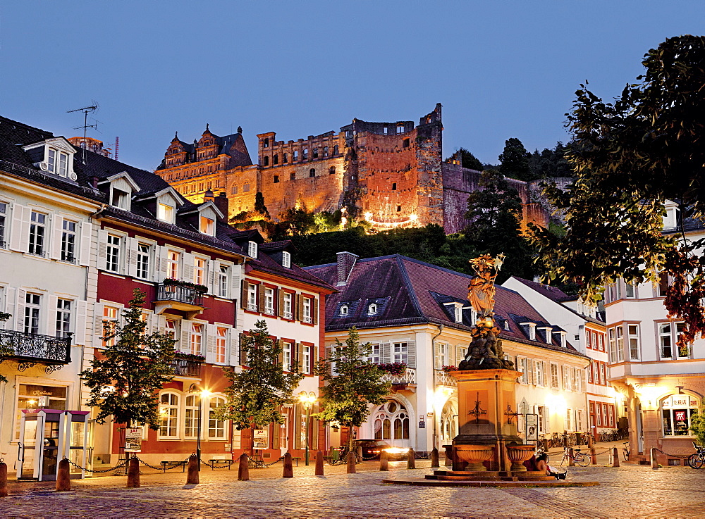 View of ruin of old castle and buildings at dusk in Heidelberg, Germany