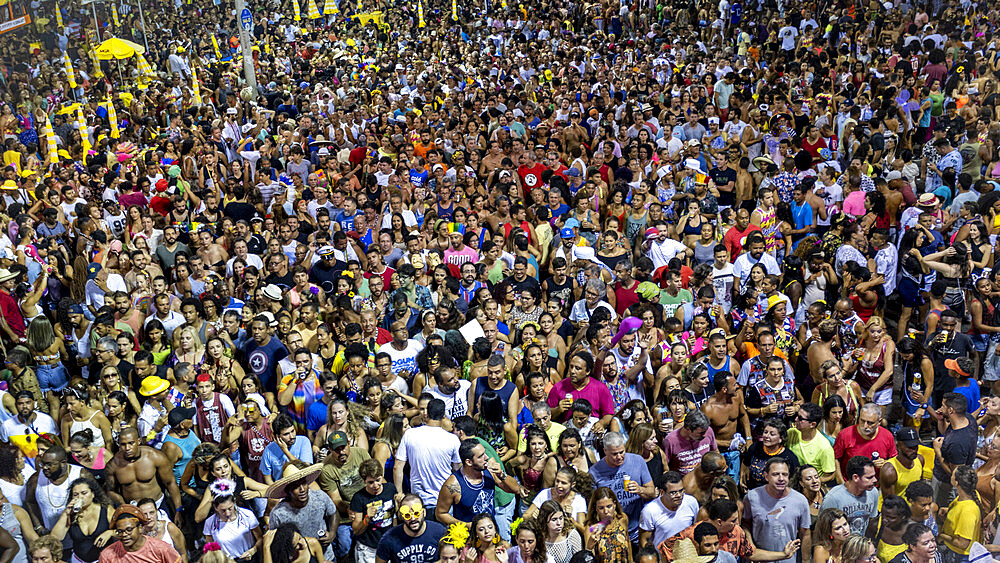 A carnival crowd following a trio electric float, Campo Grande, Salvador, Bahia, Brazil, South America
