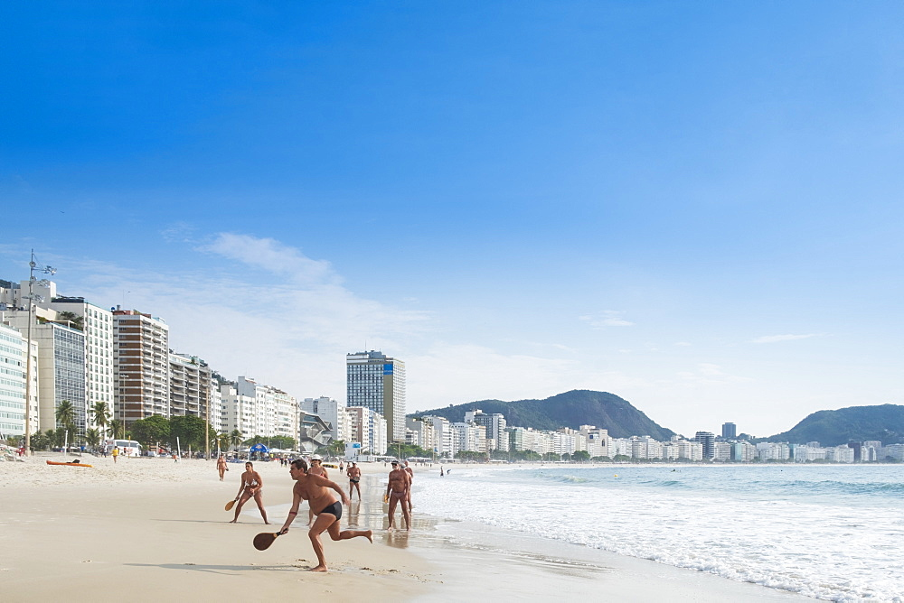Locals playing frescobol (Matkot) in the morning on Copacabana Beach, Rio de Janeiro, Brazil, South America