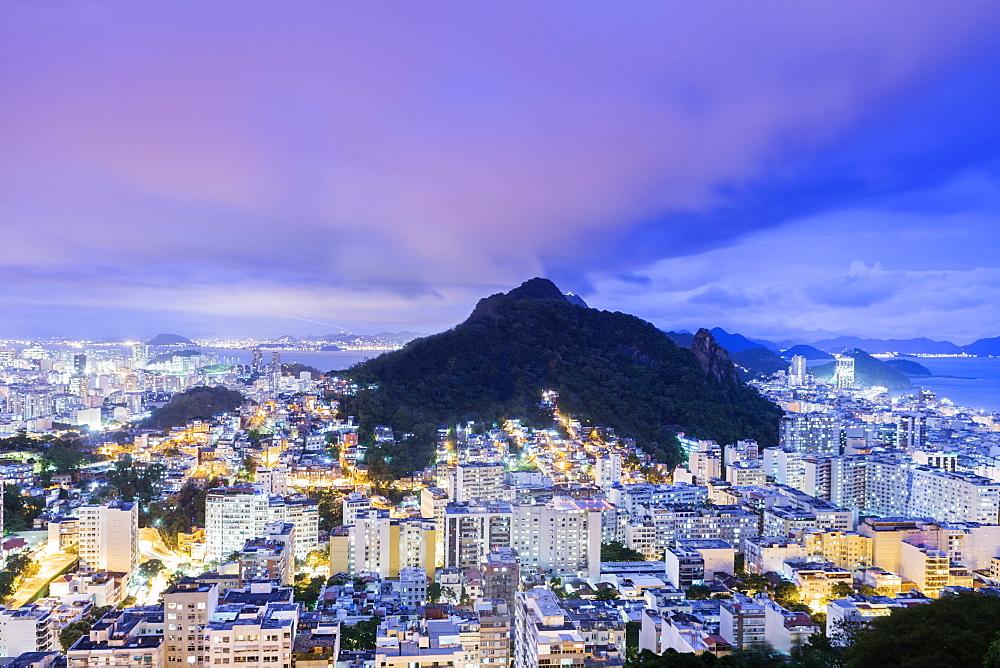 Twilight, illuminated view of Copacabana, the Morro de Sao Joao, Botafogo and the Atlantic coast of Rio, Rio de Janeiro, Brazil, South America