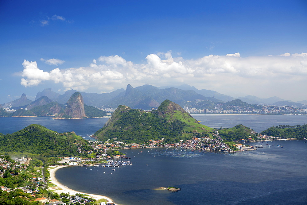 View of Rio, the Serra da Carioca mountains and Sugar Loaf with Charitas and Sao Francisco beaches in Niteroi in the foreground, Rio de Janeiro, Brazil, South America