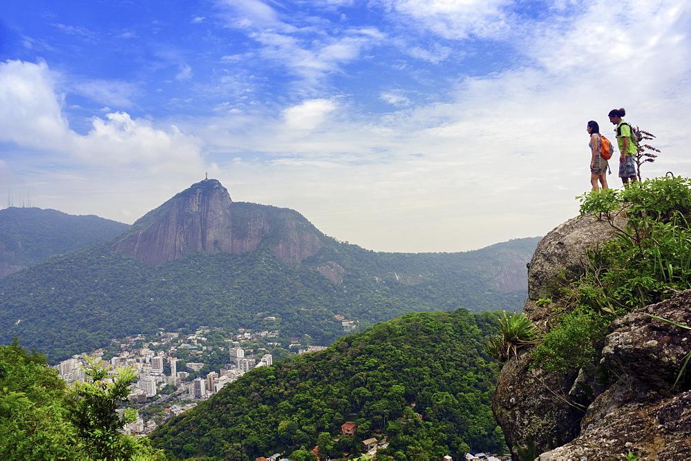 Hikers on the Morro dos Cabritos, Copacabana, Rio de Janeiro, Brazil, South America