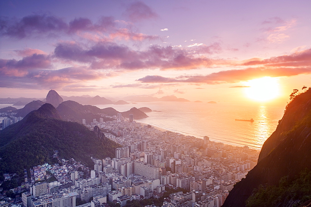 Dawn view of the Sugar Loaf, Sao Joao favela, Guanabara bay, the Atlantic and the mountains of Rio and Niteroi, Rio de Janeiro, Brazil, South America