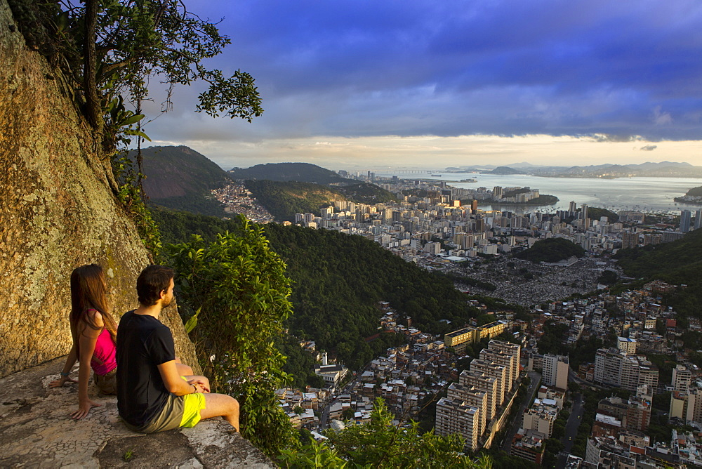 Hikers looking out over Rio from the Morro dos Cabritos, Rio de Janeiro, Brazil, South America