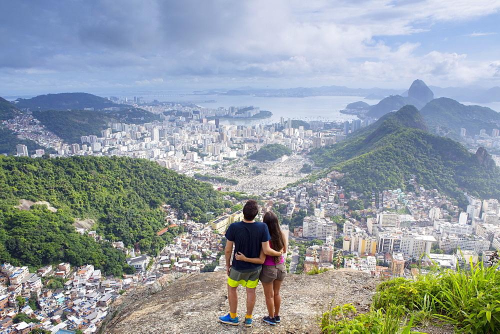 Hikers looking out over Rio de Janeiro from the Morro dos Cabritos hill, Rio de Janeiro, Brazil, South America