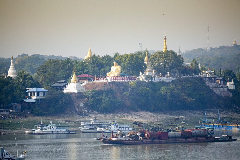 View of buddhist temples on Sagaing hill and the Irrawaddy or Ayeyarwady river from the Mandalay side of the river, Sagaing, Myanmar (Burma), Southeast Asia