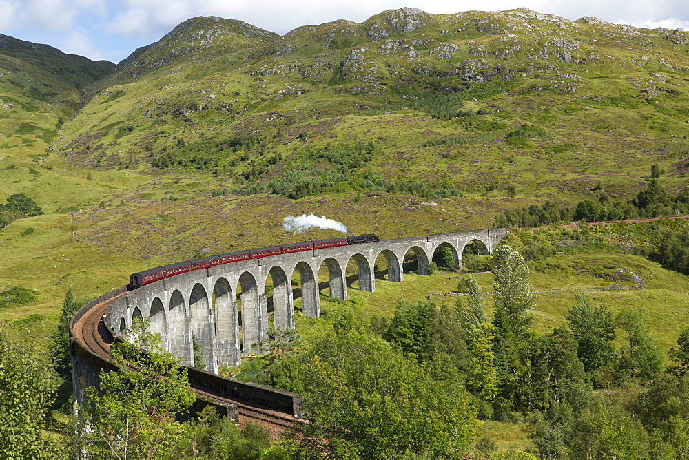The Jacobite steam train on the Glenfinnan Viadust on the Fort William to Mallaig Railway, Highlands, Scotland, United Kingdom, Europe