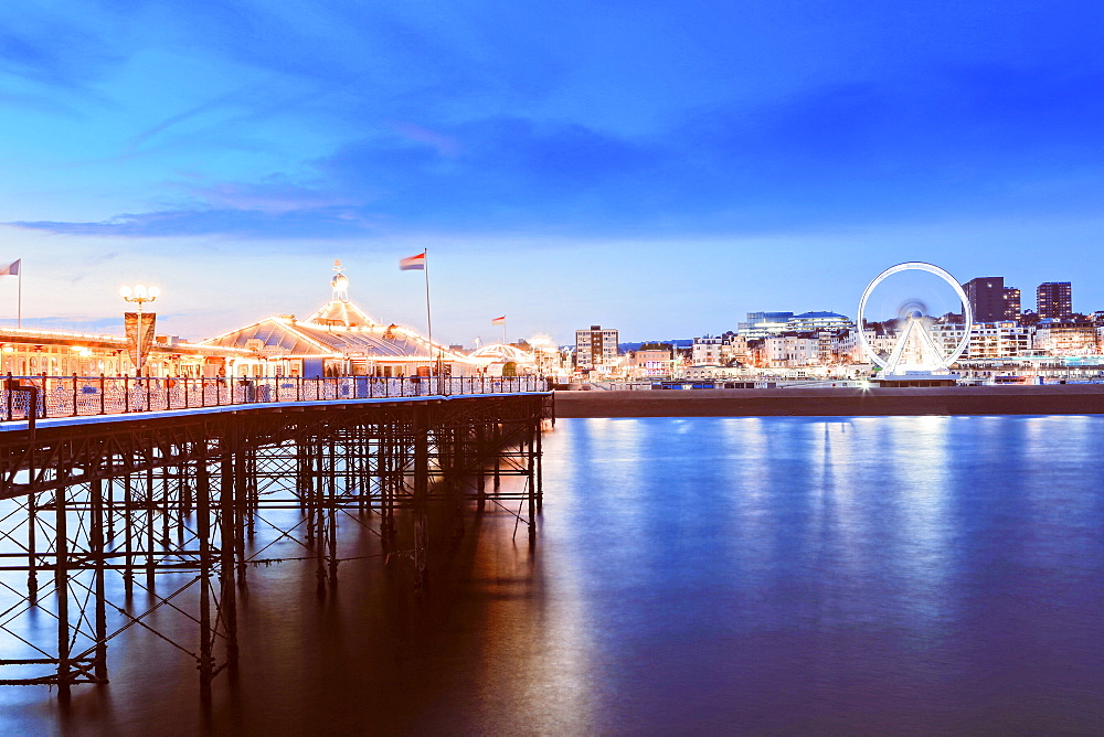 The Palace Pier (Brighton Pier) at dusk, Brighton, East Sussex, England, United Kingdom, Europe