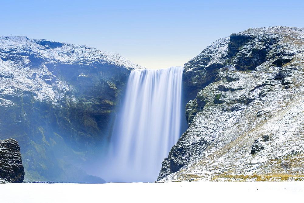 Skogafoss Waterfall in snow, Iceland, Polar Regions