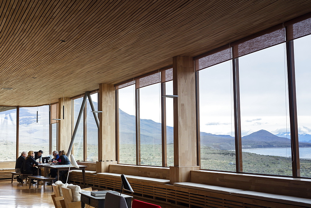 Tourists sitting in the lounge area of the Tierra Patagonia Hotel in the Torres del Paine region, Patagonia, Chile, South America