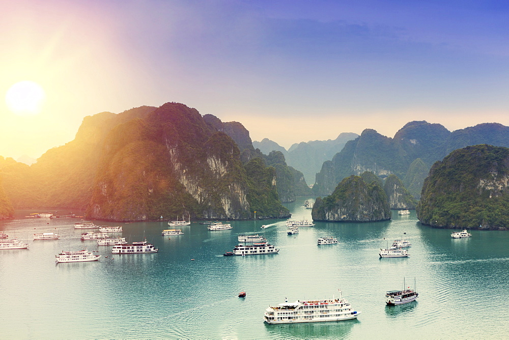 Boats on Halong Bay at sunset, UNESCO World Heritage Site, Vietnam, Indochina, Southeast Asia, Asia