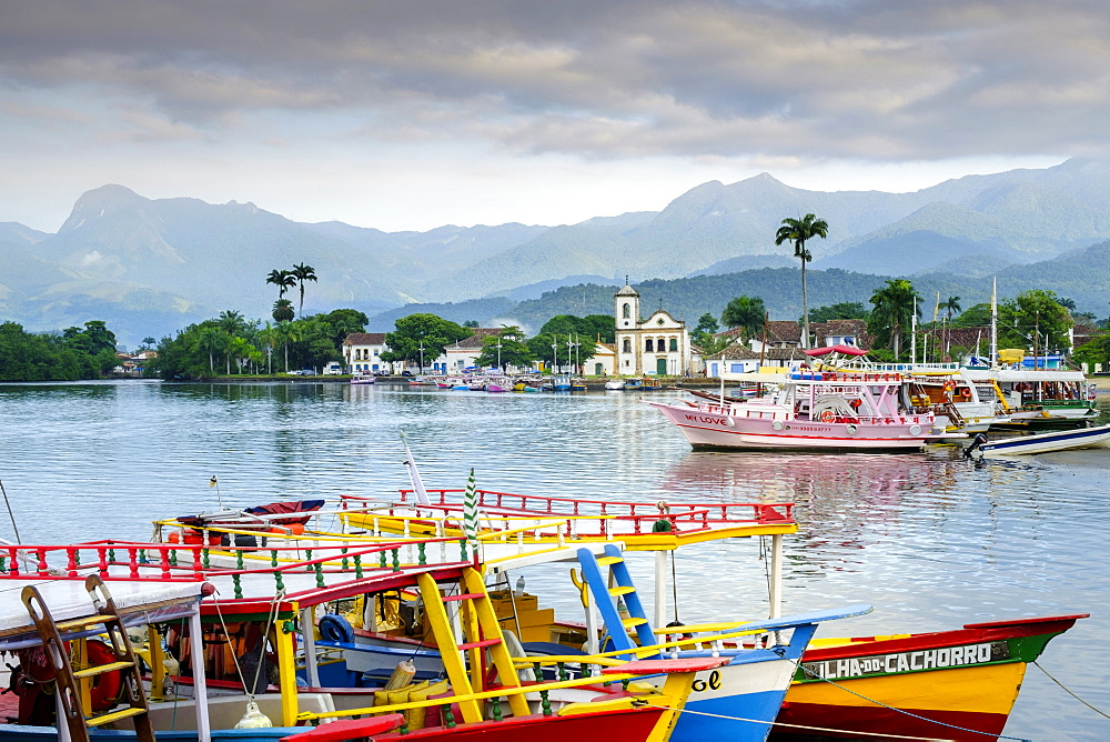 Fishing boats in Paraty village with the mountains of the Serra da Bocaina behind, Rio de Janeiro state, Brazil, South America  - 1176-693