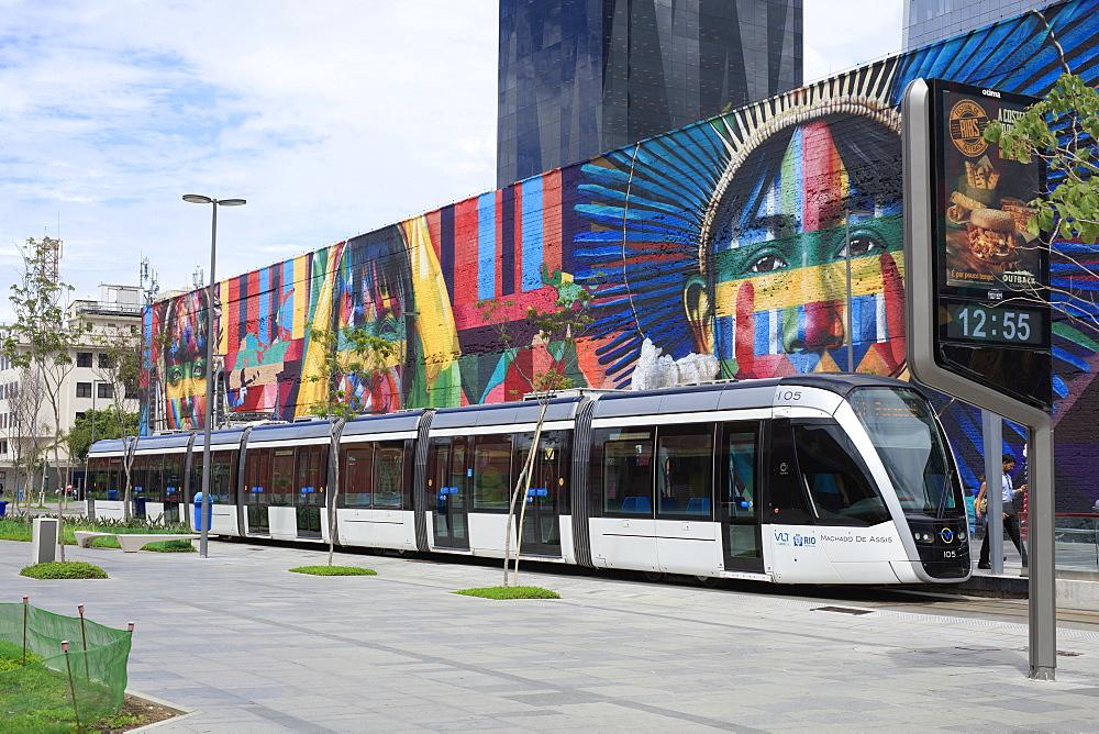 The new Rio de Janeiro VLT tram in front of a mural by Kobra in the Porto Maravilha port area, Rio de Janeiro, Brazil, South America