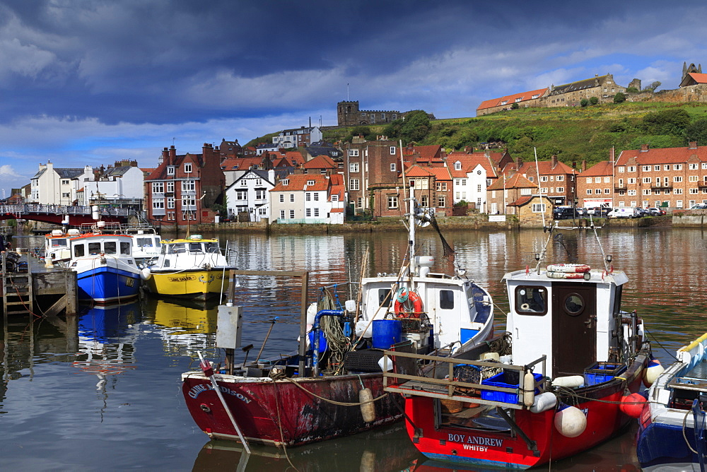 View of fishing boats in the harbour and the town centre, Whitby, Yorkshire, England, United Kingdom, Europe - 1176-809