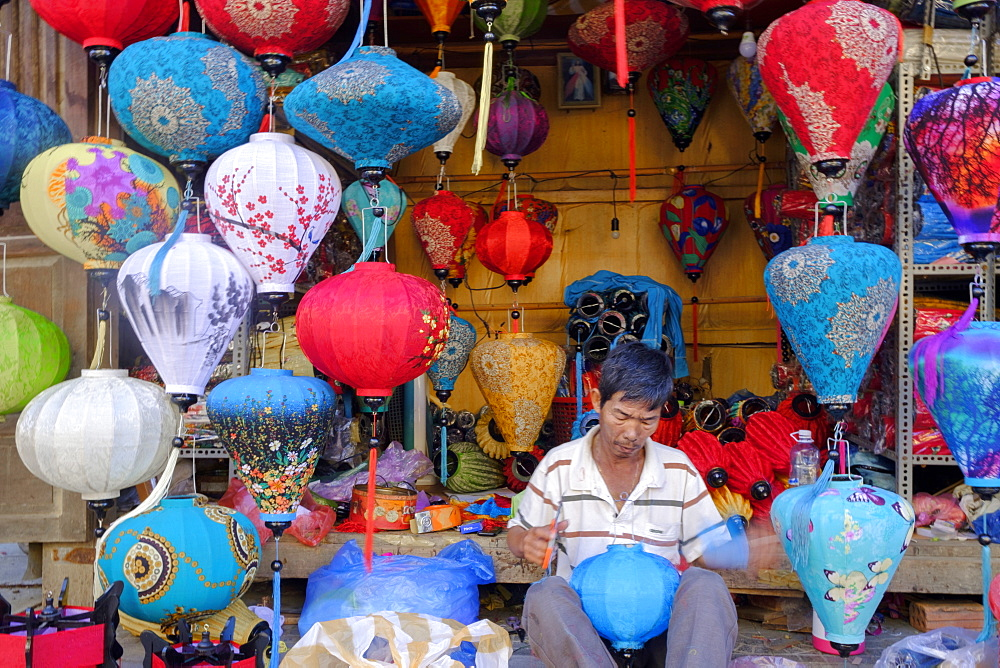 A man making paper lanterns in a shop in Hoi An, Vietnam, Indochina, Southeast Asia, Asia