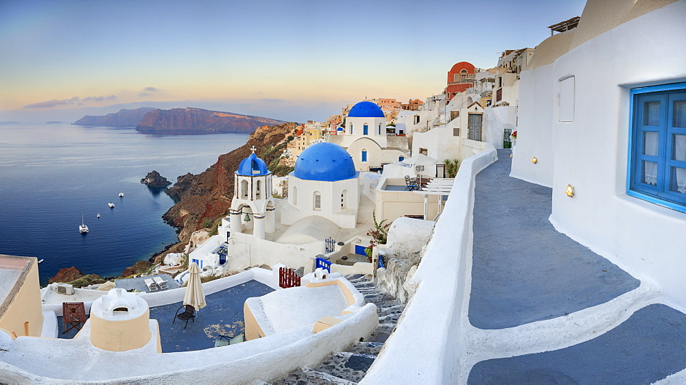 White houses and blue domes of the churches dominate the Aegean Sea, Oia, Santorini, Cyclades, Greek Islands, Greece, Europe - 1179-1024