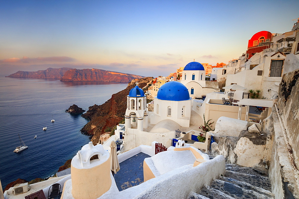 White houses and blue domes of the churches dominate the Aegean Sea, Oia, Santorini, Cyclades, Greek Islands, Greece, Europe