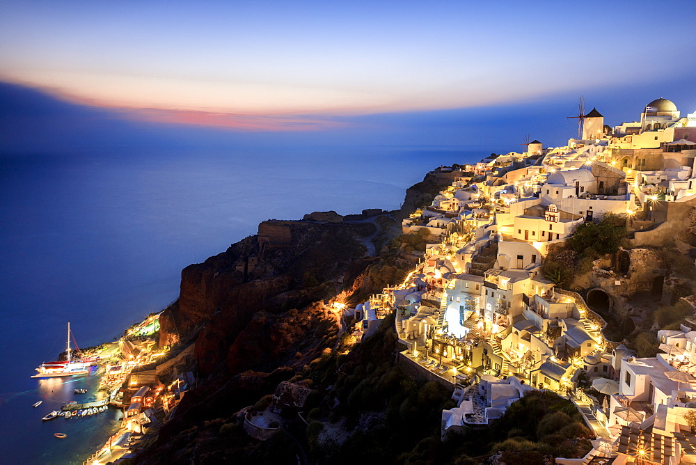 View of the Aegean Sea from the typical Greek village of Oia at dusk, Santorini, Cyclades, Greek Islands, Greece, Europe