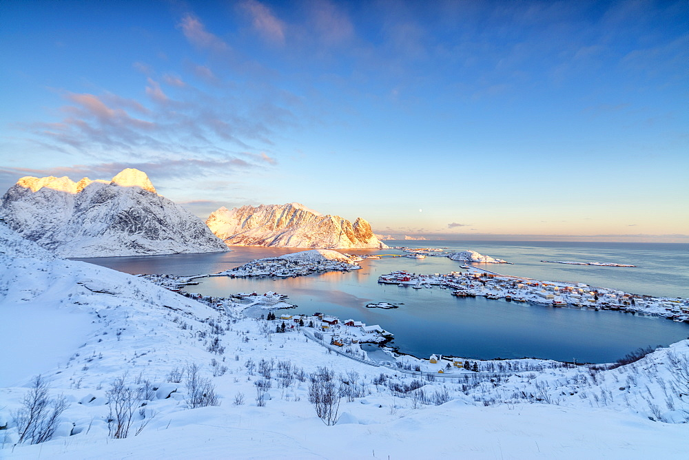 The colors of dawn frame the fishing villages surrounded by snowy peaks, Reine, Nordland, Lofoten Islands, Arctic, Norway, Scandinavia, Europe