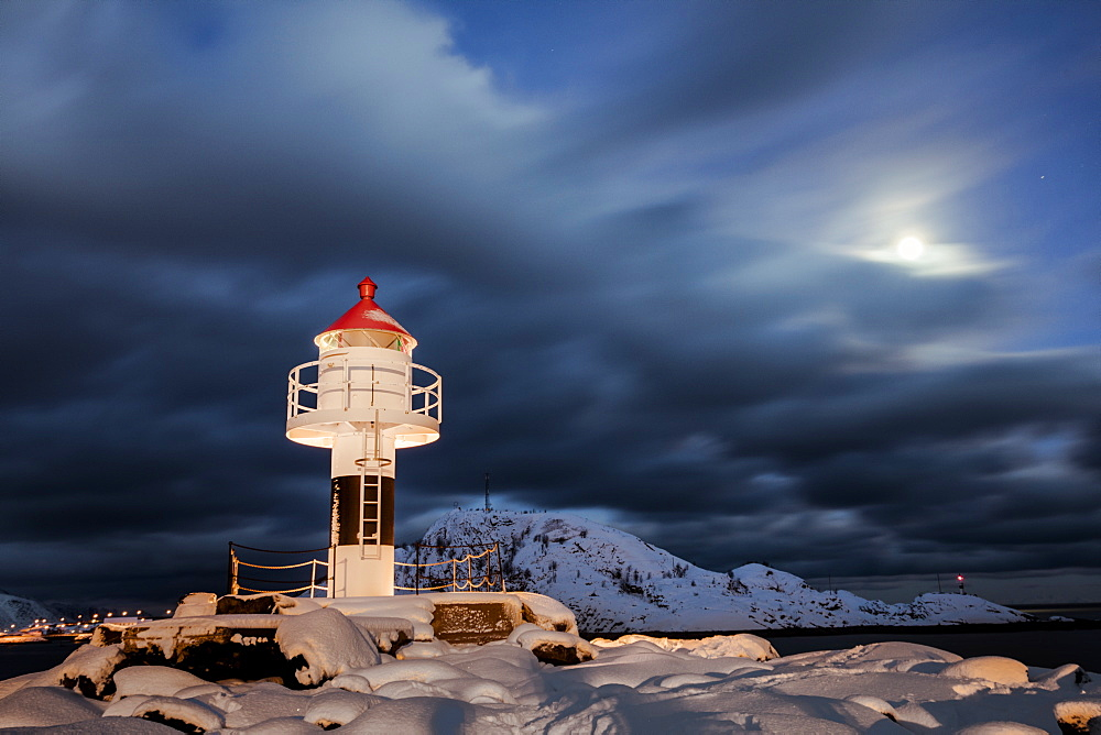 Lighthouse and full moon in the Arctic night with the village of Reine in the background, Nordland, Lofoten Islands, Arctic, Norway, Scandinavia, Europe - 1179-1102