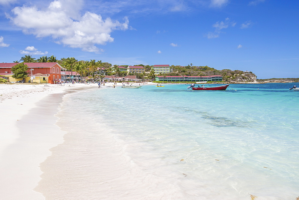 White sand and tourists frame the turquoise Caribbean sea at Long Bay Beach, Antigua and Barbuda, Leeward Islands, West Indies, Caribbean, Central America