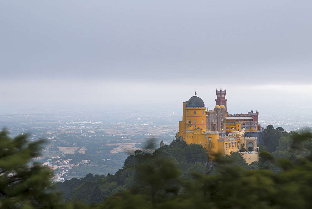 The colorful castle of Palacio da Pena, UNESCO World Heritage Site, on top of hill Sao Pedro de Penaferrim, Sintra, Lisbon district, Portugal, Europe