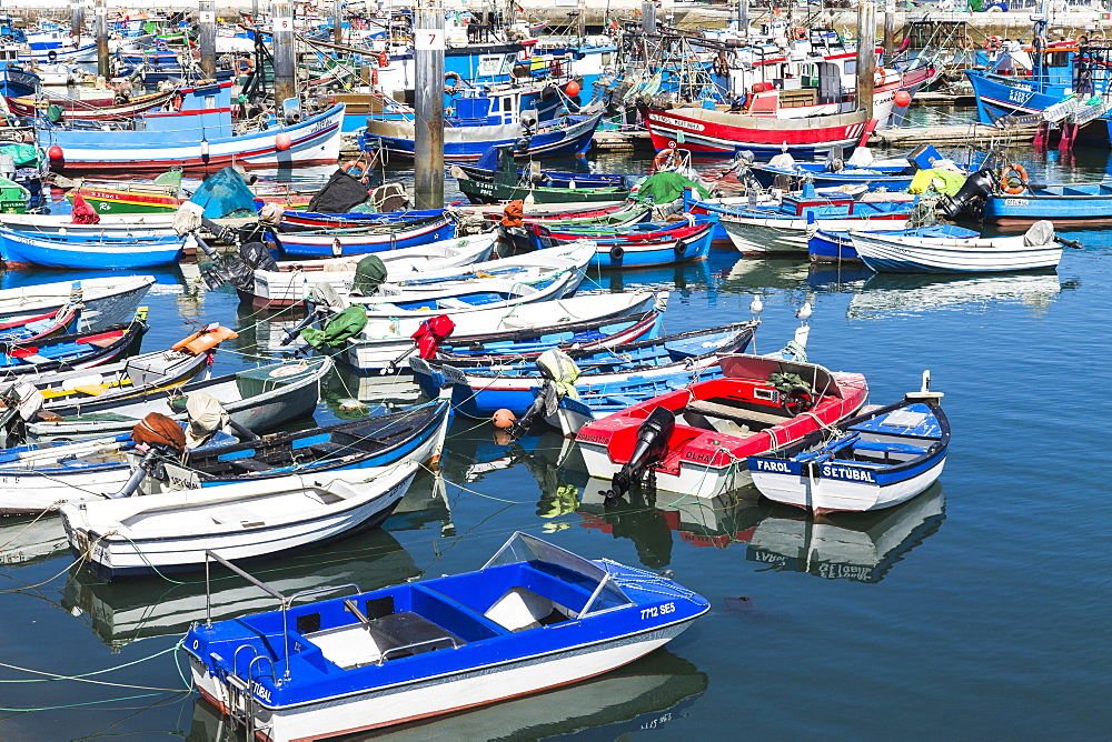 The harbor and the colorful fishing boats on a summer day, Setubal, Portugal, Europe