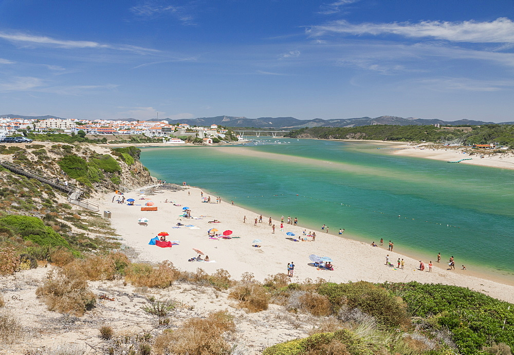 View of the sandy beach of Vila Nova de Milfontes surrounded by the turquoise ocean, Odemira, Alentejo region, Portugal, Europe