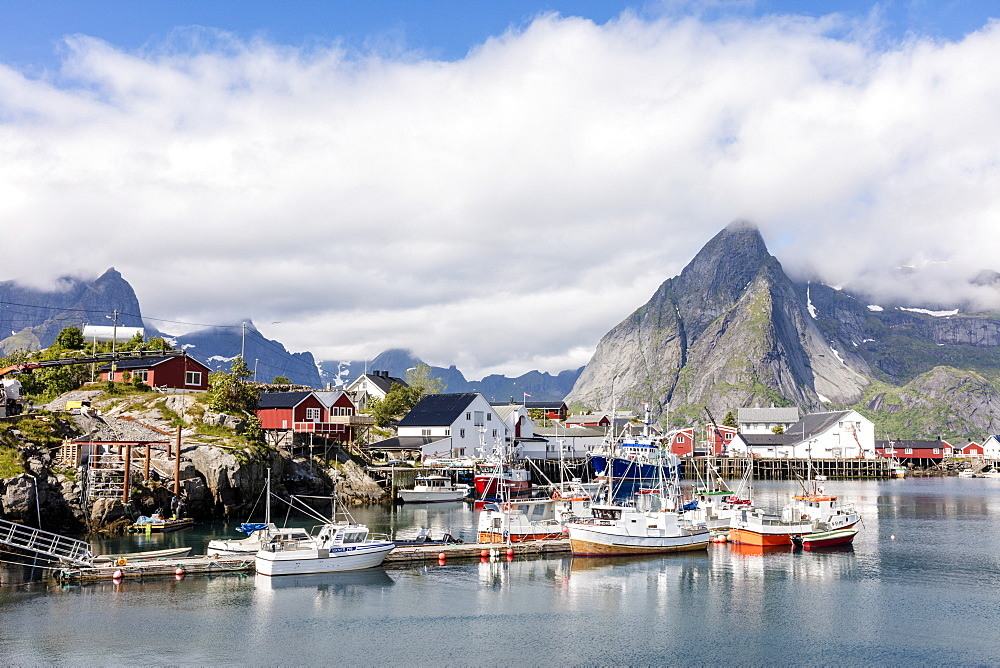 Fishing village and harbour framed by peaks and sea, Hamnoy, Moskenes, Nordland county, Lofoten Islands, Arctic, Northern Norway, Scandinavia, Europe