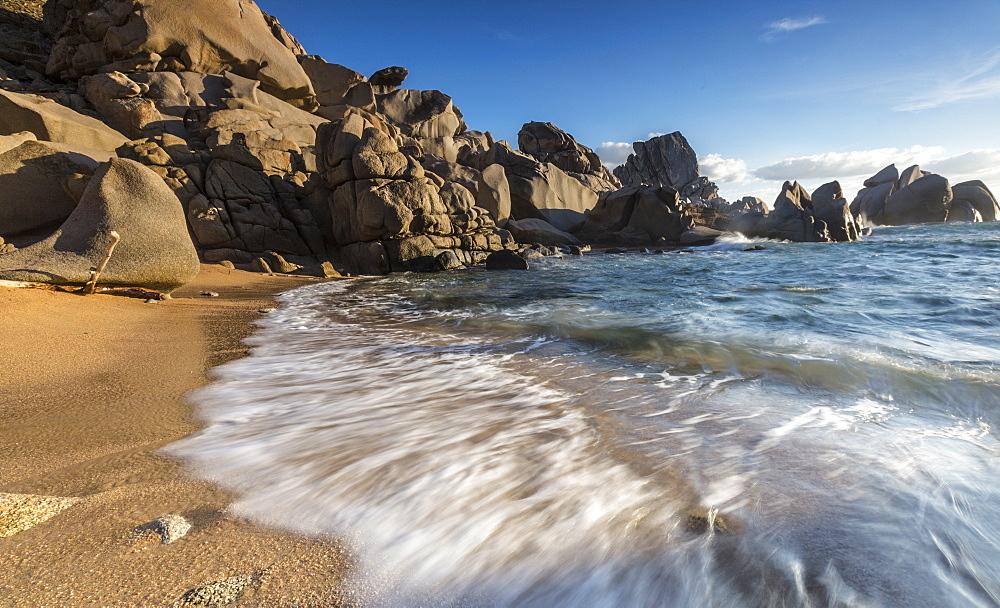 Waves crashing on the sandy beach framed by cliffs, Capo Testa, Santa Teresa di Gallura, Province of Sassari, Sardinia, Italy, Mediterranean, Europe