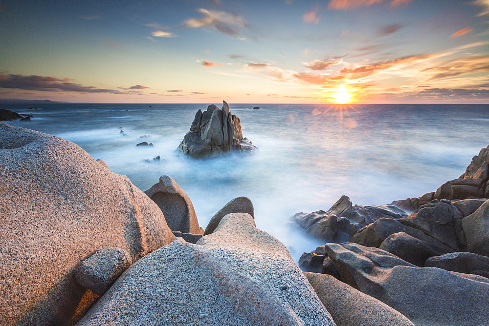 The light of sunset on blue sea framed by cliffs, Capo Testa, Santa Teresa di Gallura, Province of Sassari, Sardinia, Italy, Mediterranean, Europe