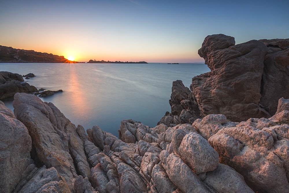 White cliffs and blue sea framed by the lights of sunset Santa Teresa di Gallura Province of Sassari Sardinia Italy Europe