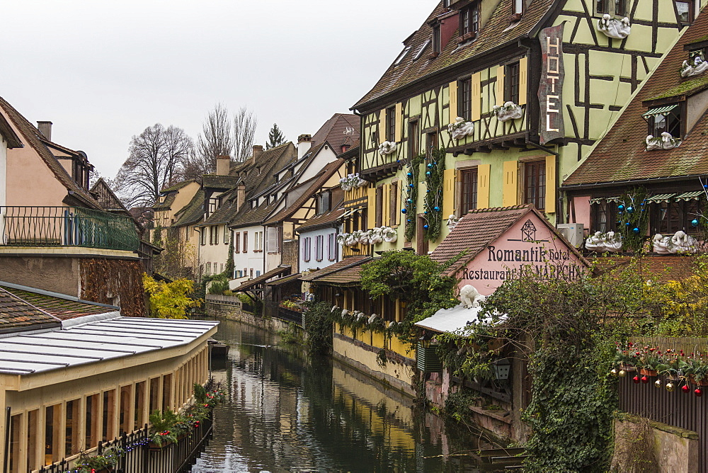 Colored houses reflected in river Lauch at Christmas time, Petite Venise, Colmar, Haut-Rhin department, Alsace, France, Europe