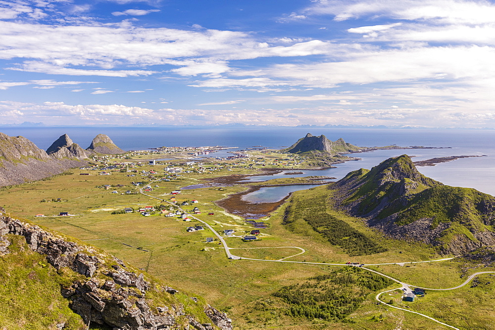 View of village of Sorland framed by green meadows and sea, Vaeroy Island, Nordland county, Lofoten archipelago, Norway, Scandinavia, Europe