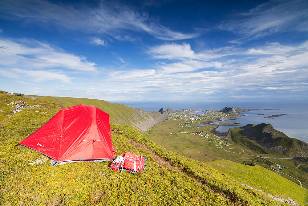 Tent on mountain ridge overlooking meadows and sea, Sorland, Vaeroy Island, Nordland county, Lofoten archipelago, Norway, Scandinavia, Europe