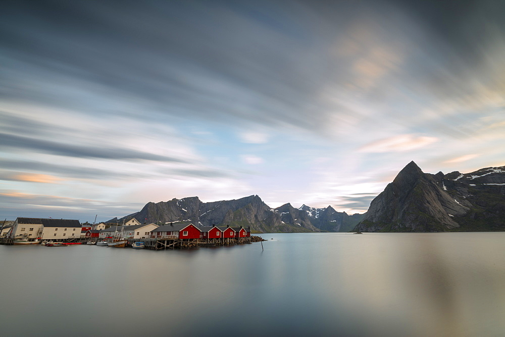 The summer sunset at night on fishing village and cold sea, Hamnoy, Moskenesoya, Nordland county, Lofoten Islands, Norway, Scandinavia, Europe