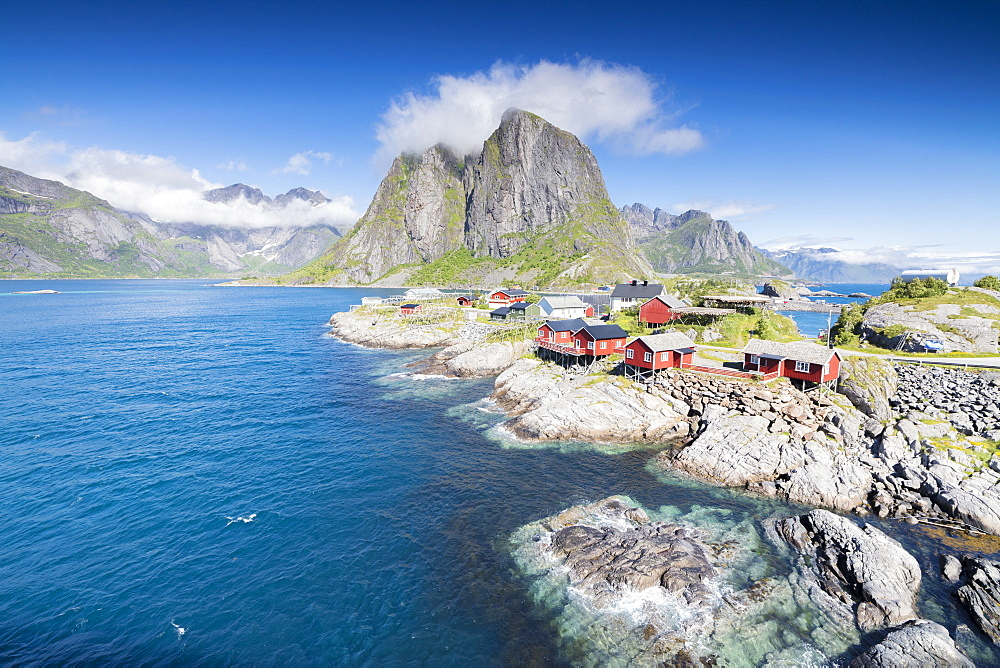 Top view of the fishing village framed by blue sea and high peaks Hamnoy, Moskenesoya, Nordland county, Lofoten Islands, Norway, Scandinavia, Europe