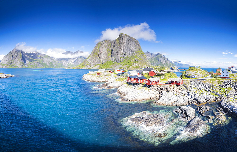 Panorama of the fishing village framed by blue sea and high peaks, Hamnoy, Moskenesoya, Nordland county, Lofoten Islands, Norway, Scandinavia, Europe