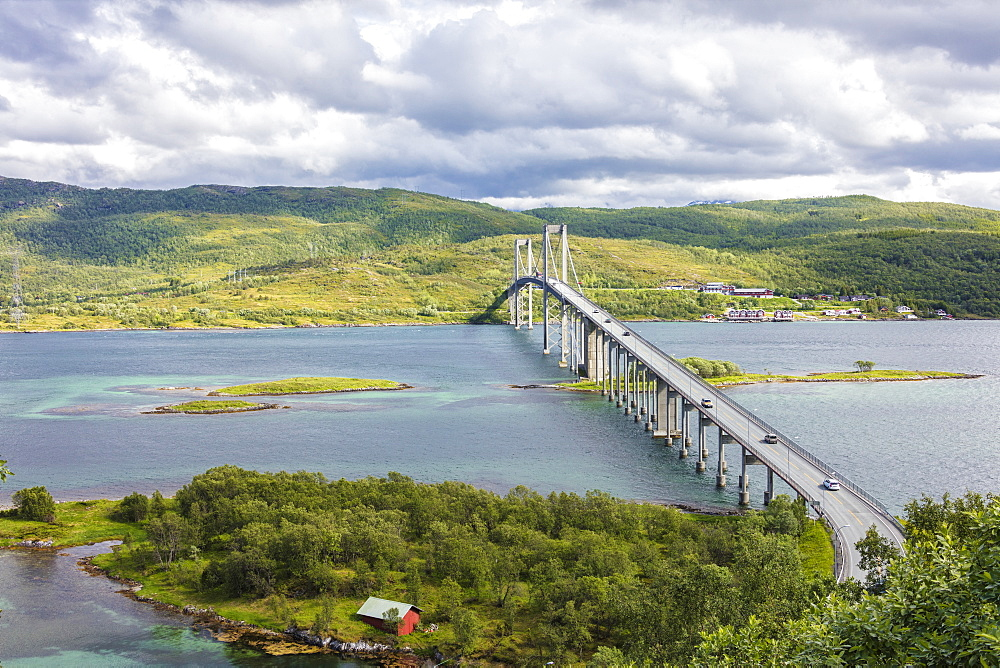 Green hills and turquoise sea frame the suspension road bridge in Tjeldsundbrua, Troms county, Nordland, Norway, Scandinavia, Europe