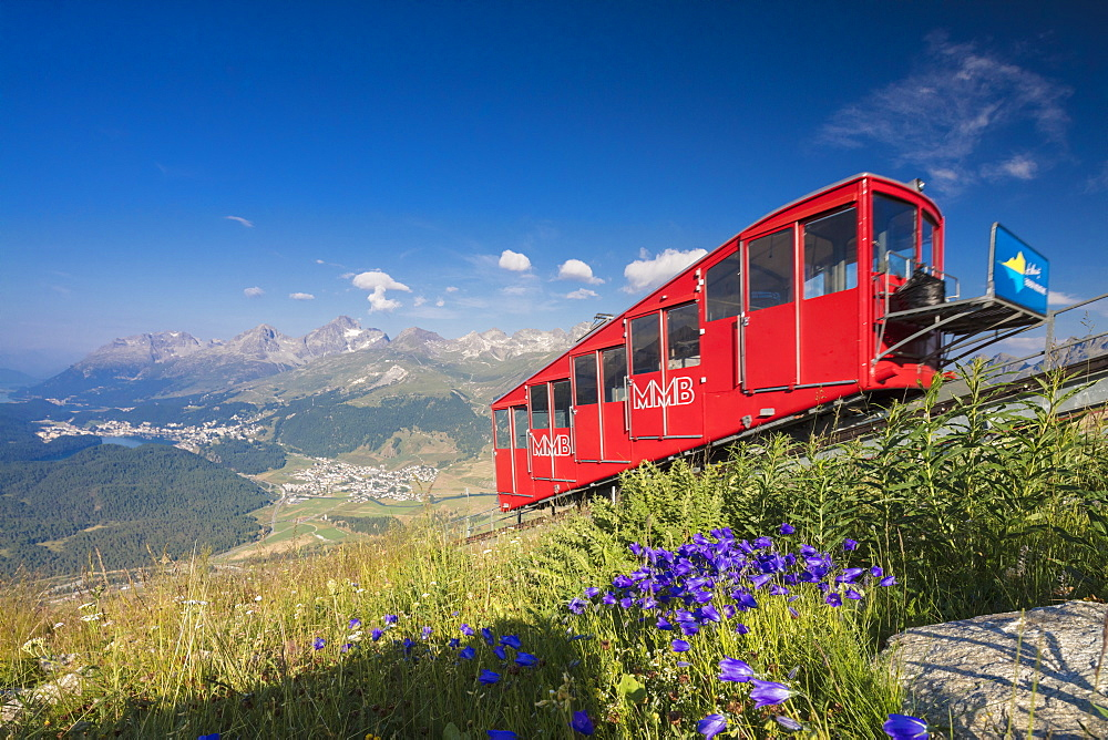 The funicular railway runs across the alpine meadows, Muottas Muragl, Samedan, Canton of Graubunden, Engadine, Switzerland, Europe