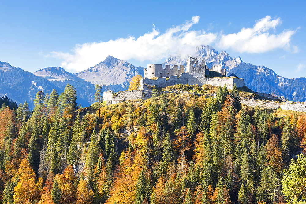 View of the old Ehrenberg Castle surrounded by colorful woods and rocky peaks Reutte Austria Europe