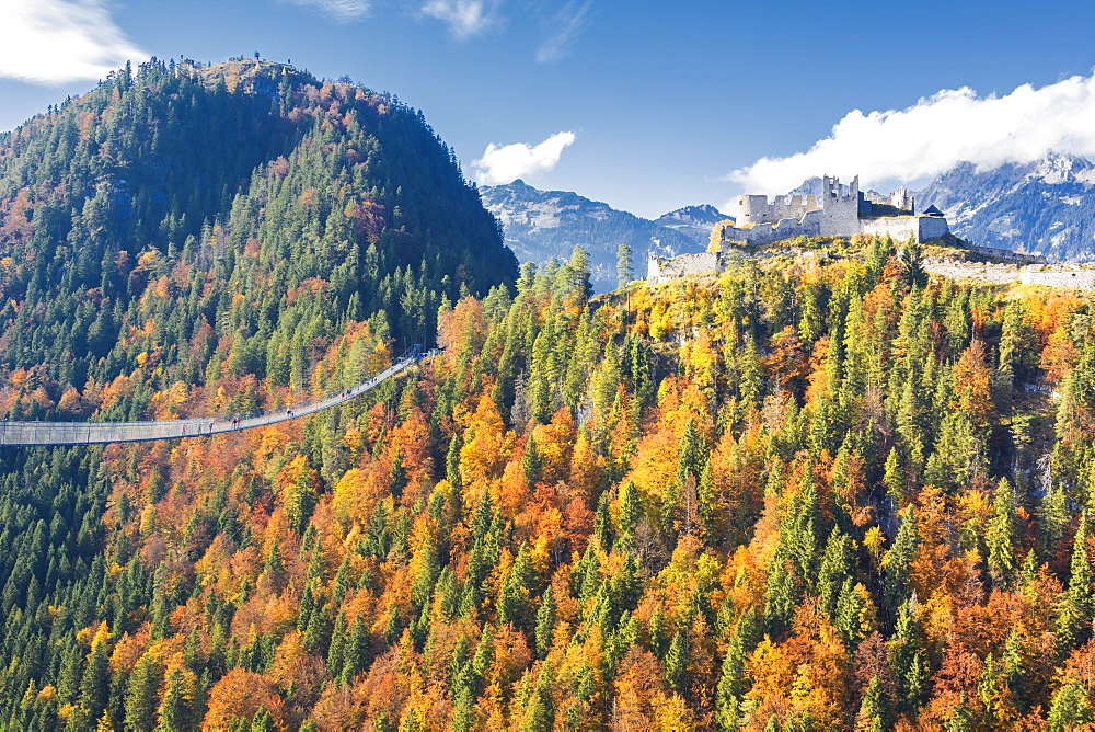View of the old Ehrenberg Castle surrounded by colorful woods and suspension bridge, Highline 179, Reutte, Austria, Europe