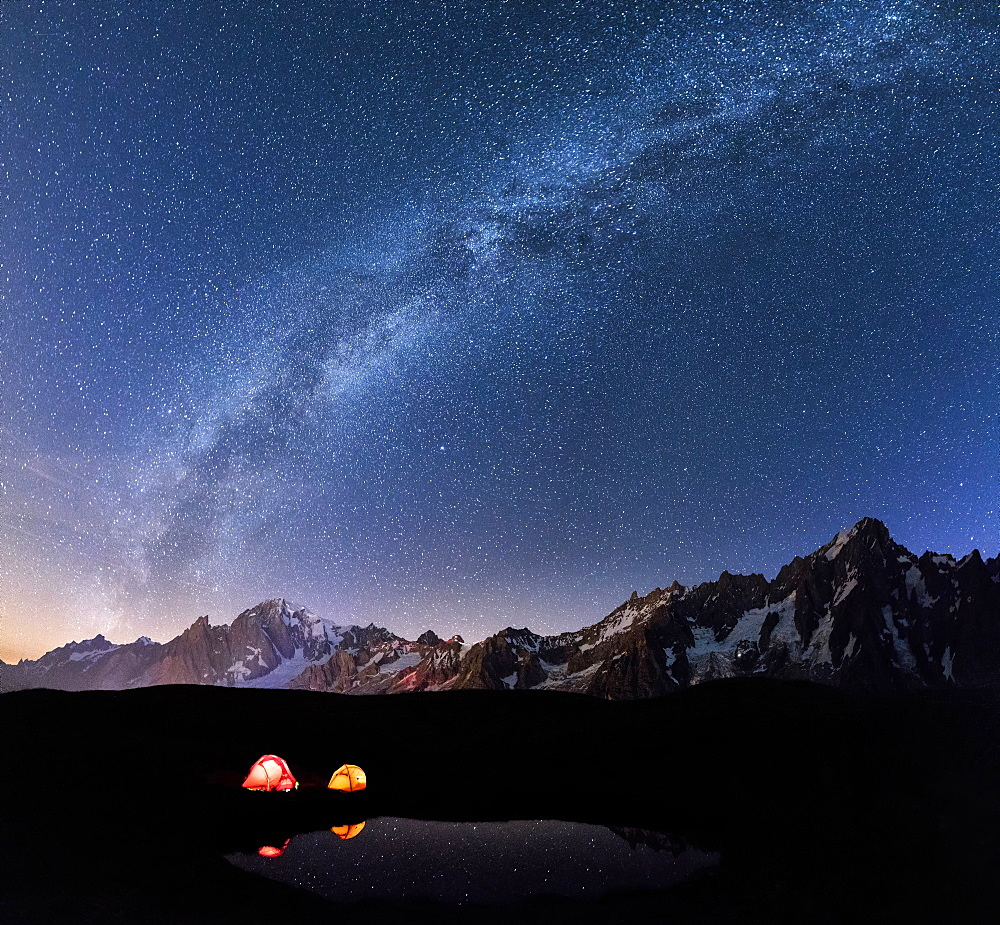 Panorama of Mont Blanc, Mont De La Saxe and Grand Jorasses under the starry sky, Graian Alps, Courmayeur, Aosta Valley, Italy, Europe